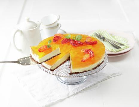 Mager ostekake med gelétopp og appelsiner - stykke